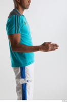 Tiago  1 arm blue t shirt dressed flexing side view sports 0003.jpg