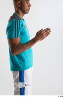 Tiago  1 arm blue t shirt dressed flexing side view sports 0004.jpg