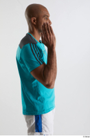 Tiago  1 arm blue t shirt dressed flexing side view sports 0005.jpg